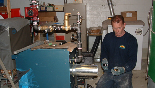 Man working on hot water heater